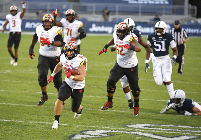 FILE - In this Nov.  7, 2020, file photo, Maryland running back Jake Funk (34) scores a touchdown during the second quarter of an NCAA college football game against Penn State in State College, Pa. Maryland, coming off a milestone win over Penn State, faces Indiana on Saturday. (AP Photo/Barry Reeger, File)