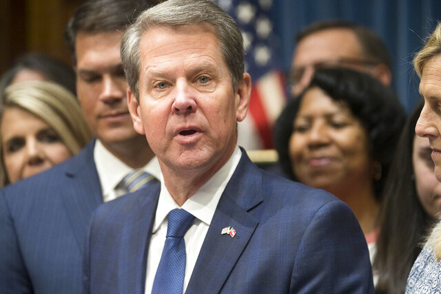 FILE- In this May 7, 2019, file photo, Georgia Gov. Brian Kemp speaks during a press conference for the signing of HB 481 at the Georgia State Capitol building in Atlanta,. he law, signed by Brian Kemp in May, was set to become enforceable Jan. 1, 2020. But a lawsuit challenging it was filed in June on behalf of Georgia abortion providers and an advocacy group, and U.S. District Judge Steve Jones in October temporarily blocked the law. (Alyssa Pointer/Atlanta Journal-Constitution via AP, File)