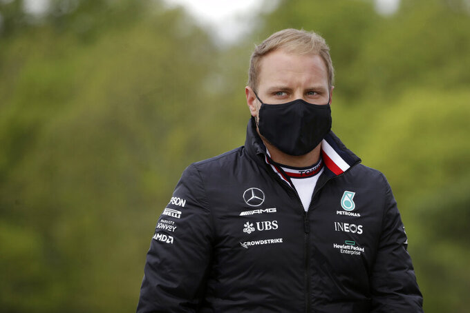 Mercedes driver Valtteri Bottas, of Finland, inspects the racetrack ahead of Sunday's Emilia Romagna Formula One Grand Prix, at the Imola track, Italy, Thursday, April 15, 2021. (AP Photo/Luca Bruno)