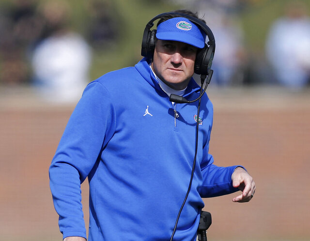 FILE - In this Nov. 16, 2019, file photo, Florida head coach Dan Mullen watches from the sideline during the first half of an NCAA college football game against Missouri in Columbia, Mo. Mullen had several players miss the team's opening training camp practice Monday, Aug. 17, 2020. (AP Photo/Jeff Roberson, File)