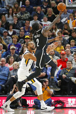 Brooklyn Nets forward Taurean Prince (2) lays the ball up as Utah Jazz center Rudy Gobert defends in the first half of an NBA basketball game Tuesday, Nov. 12, 2019, in Salt Lake City. (AP Photo/Rick Bowmer)