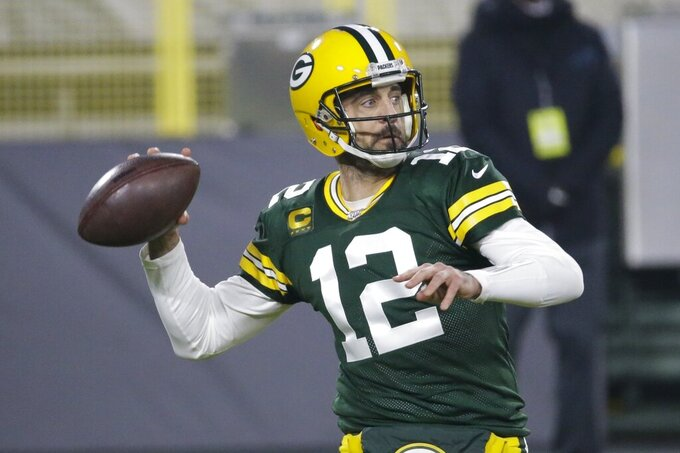 Green Bay Packers' Aaron Rodgers throws during the first half of an NFL football game against the Carolina Panthers Saturday, Dec. 19, 2020, in Green Bay, Wis. (AP Photo/Mike Roemer)