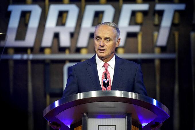 MLB Commissioner Rob Manfred kicks off the first round of the 2021 MLB baseball draft, Sunday, July 11, 2021, in Denver. (AP Photo/David Zalubowski)