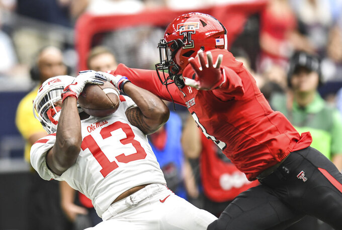 Mississippi's Braylon Sanders (13) makes a catch against Texas Tech's Douglas Coleman III (3) during an NCAA college football game against Texas Tech, Saturday, Sept. 1, 2018, at NRG Stadium in Houston. (Bruce Newman/The Oxford Eagle via AP)