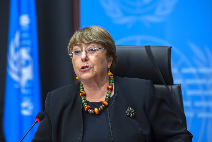 """FILE - In this Wednesday, Dec. 9, 2020 file photo Michelle Bachelet, UN High Commissioner for Human Rights, speaks during a press conference at the European headquarters of the United Nations in Geneva, Switzerland. The U.N. human rights chief on Monday urged countries to enact """"a wide range of reparations measures"""" as part of efforts to address the legacies of slavery, colonial rule and racial discrimination. (Martial Trezzini/Keystone via AP, file)"""