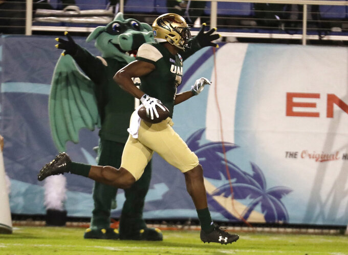 UAB wide receiver Xavier Ubosi runs to score a touchdown during the second half of the Boca Raton Bowl NCAA college football game against Northern Illinois, Tuesday, Dec. 18, 2018, in Boca Raton, Fla. UAB won 37-13. (AP Photo/Lynne Sladky)