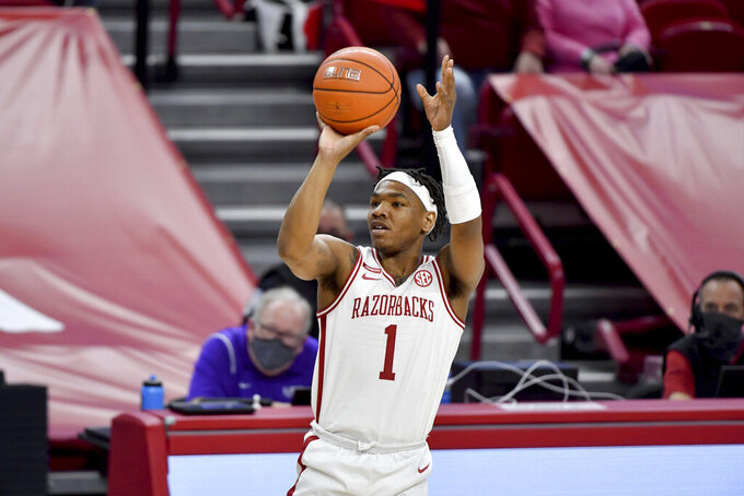 FILE - Arkansas guard JD Notae (1) shoots against LSU during the first half of an NCAA college basketball game in Fayetteville, Ark., in this Saturday, Feb. 27, 2021, file photo. The Razorbacks won nine of its last 10 games before the NCAA Tournament last season and advanced to the Elite Eight. The Razorbacks enter this season ranked 16th. J.D. Notae returns to lead the way. (AP Photo/Michael Woods, File)