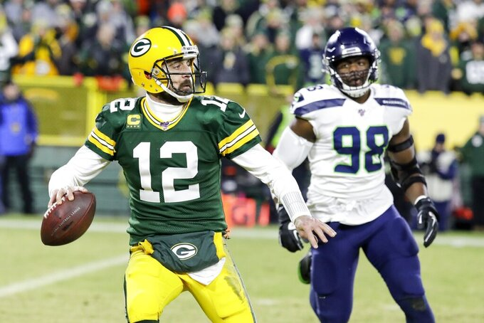 Green Bay Packers' Aaron Rodgers scrambles during the first half of an NFL divisional playoff football game against the Seattle Seahawks Sunday, Jan. 12, 2020, in Green Bay, Wis. (AP Photo/Darron Cummings)