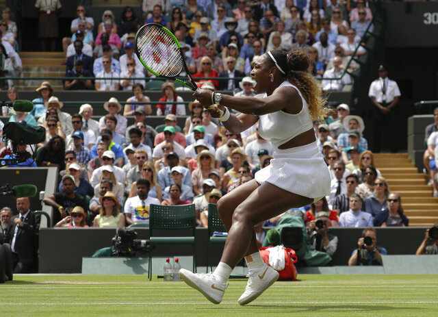 FILE - In this July 8, 2019, file photo, United States' Serena Williams returns the ball to Spain's Carla Suarez Navarro in a women's singles match during day seven of the Wimbledon Tennis Championships in London.  After the traditional middle Sunday off, Wimbledon would have resumed this week with what some consider the most exciting day of tennis: The second Monday, when all 16 men's and women's singles matches in the fourth round are scheduled. Of the 19 times Williams has entered Wimbledon, she reached Week 2 of the fortnight on 16 occasions; that includes seven of her 23 Grand Slam singles trophies and another four runner-up finishes, including in 2018 and 2019. (AP Photo/Kirsty Wigglesworth, File)
