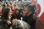 Oakland Mayor Libby Schaaf, left, talks with Misty Cross, center, Tolani King, center right, and Sharena Thomas, right, all from the group Moms 4 Housing, at a rally outside of City Hall in Oakland, Calif., Tuesday, Jan. 7, 2020. Some California lawmakers said they support a group of homeless women who have been illegally living in a vacant three-bedroom house since November, partly to protest real estate speculators who drive up housing costs in the pricey San Francisco Bay Area. (AP Photo/Jeff Chiu)