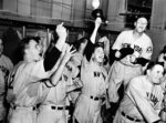 FILE - This Oct. 8, 1939, file photo shows New York Yankees baseball players celebrating in the locker room after beating the Cincinnati Reds 7-4 in Game 4 to win the World Series, at Crosby Field in Cincinnati. Babe Dahlgren is at left foreground. Buddy Rosar is at center holding up his hat and coach Art Fletcher, stands on a trunk, second from right. (AP Photo/File)