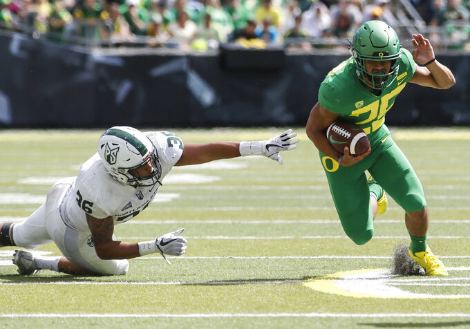 Oregon wide receiver Kyle Buckner (25) gains yards on Portland State linebacker Sam Bodine (36) during an NCAA college football game in Eugene, Ore., Saturday, Sept. 8, 2018. (AP Photo/Thomas Boyd)