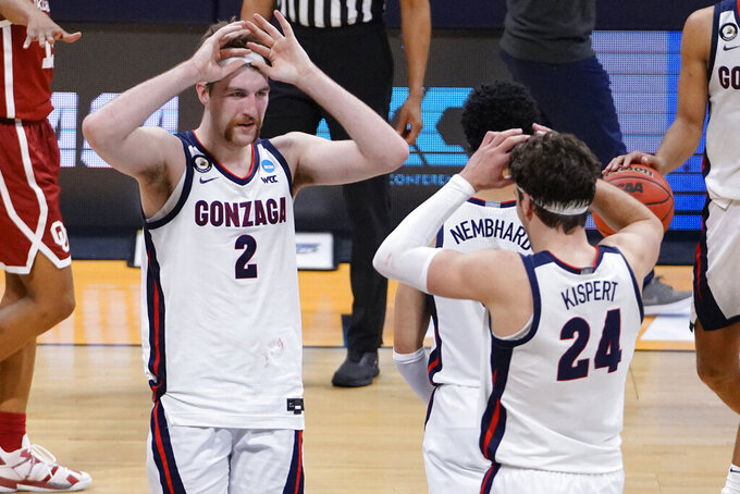 Gonzaga forward Drew Timme (2) celebrates with teammate Corey Kispert (24) after defeating Oklahoma in the second round of the NCAA college basketball tournament at Hinkle Fieldhouse in Indianapolis, Monday, March 22, 2021. (AP Photo/AJ Mast)