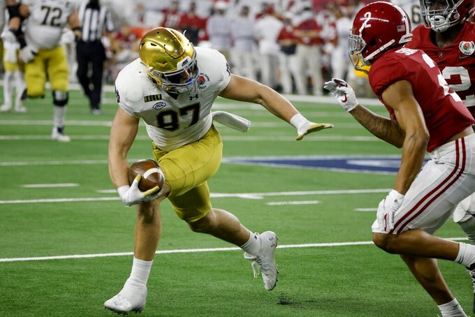 Notre Dame tight end Michael Mayer (87) gains yardage after a catch as Alabama defensive back Patrick Surtain II (2) moves in to make the stop in the second half of the Rose Bowl NCAA college football game in Arlington, Texas, Friday, Jan. 1, 2021. (AP Photo/Michael Ainsworth)