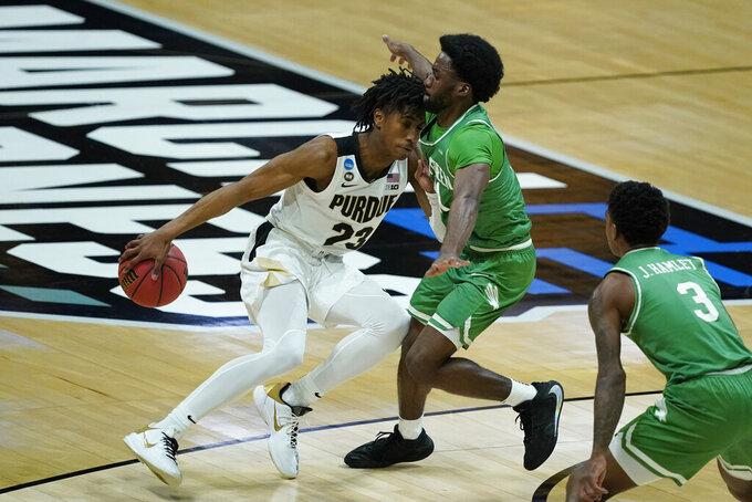 Purdue's Jaden Ivey (23) is defended by North Texas's JJ Murray (11) during the first half of a first-round game in the NCAA men's college basketball tournament at Lucas Oil Stadium, Friday, March 19, 2021, in Indianapolis. (AP Photo/Darron Cummings)