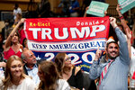 Supporters react to music before President Donald Trump arrives at a Latinos for Trump Coalition roundtable at Arizona Grand Resort & Spa, Monday, Sept. 14, 2020, in Phoenix. (AP Photo/Andrew Harnik)