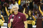 FILE - Florida State's new head football coach Mike Norvell smiles after being introduced during half-time of an NCAA college basketball game against Clemson in Tallahassee, Fla., Sunday, Dec. 8, 2019. Norvell's first season at Florida State should be an upgrade from the Willie Taggart era. Taggart's tenure was one of college football's biggest coaching debacles in recent years. He posted four winning seasons at Memphis before taking over in Florida's capital. He's now tasked with getting the Seminoles back to national prominence. (AP Photo/Mark Wallheiser, File)