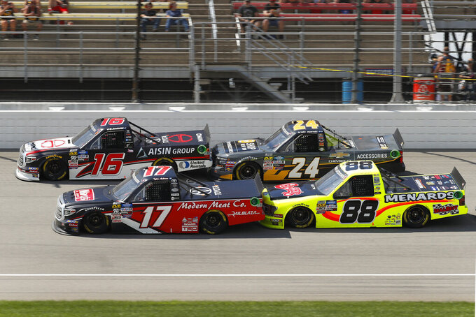 Tyler Ankrum (17), Austin Hill (16), Brett Moffitt (24), and Brett Moffitt (88) race during a NASCAR Truck Series race at Michigan International Speedway in Brooklyn, Mich., Saturday, Aug. 10, 2019. (AP Photo/Paul Sancya)