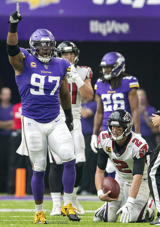 Minnesota Vikings' Everson Griffen (97) celebrates after sacking Atlanta Falcons quarterback Matt Ryan (2) in the third quarter of an NFL football game Sunday, Sept. 8, 2019, in Minneapolis. (Carlos Gonzalez/Star Tribune via AP)
