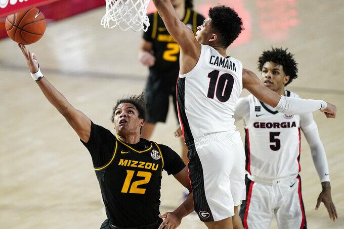 Missouri's Dru Smith (12) shoots against Georgia's Toumani Camara (10) during the first half of an NCAA college basketball game Tuesday, Feb. 16, 2021, in Athens, Ga. (AP Photo/Brynn Anderson)