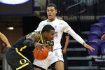 Oregon's Amauri Hardy, left, collides with Washington's Quade Green during the second half of an NCAA college basketball game Saturday, Dec. 12, 2020, in Seattle. (AP Photo/Elaine Thompson)