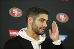 San Francisco 49ers quarterback Jimmy Garoppolo gestures while speaking during a news conference after loosing to the Baltimore Ravens in a NFL football game, Sunday, Dec. 1, 2019, in Baltimore, Md. Ravens won 20-17. (AP Photo/Julio Cortez)