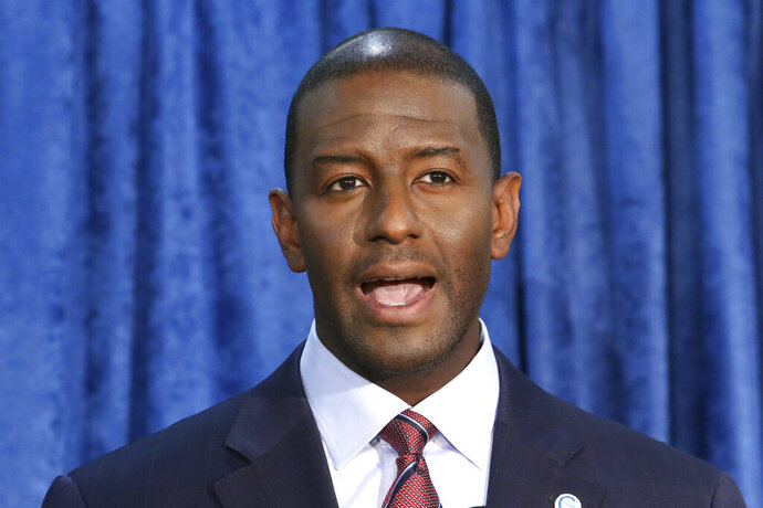FILE - In this Nov. 10, 2018 file photo, Andrew Gillum, then-Democratic candidate for governor, speaks at a news conference in Tallahassee, Fla. Guillum told a television interviewer, Monday, Sept. 14, 2020, that he is bisexual. Gillum was responding to rumors swirling since March when he was found intoxicated in a hotel room with two men, including one who works as a male escort. (AP Photo/Steve Cannon, File)
