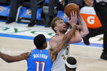 Indiana Pacers forward Domantas Sabonis, right, is fouled by Oklahoma City Thunder guard Theo Maledon, left,  in the second half of an NBA basketball game Saturday, May 1, 2021, in Oklahoma City. (AP Photo/Sue Ogrocki)