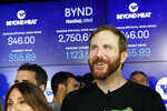 FILE - In this May 2, 2019, file photo Beyond Meat CEO Ethan Brown watches as his company's stock begins to trade following its IPO at Nasdaq in New York. Beyond Meat reports financial earns Monday, Oct. 28. (AP Photo/Mark Lennihan, File)