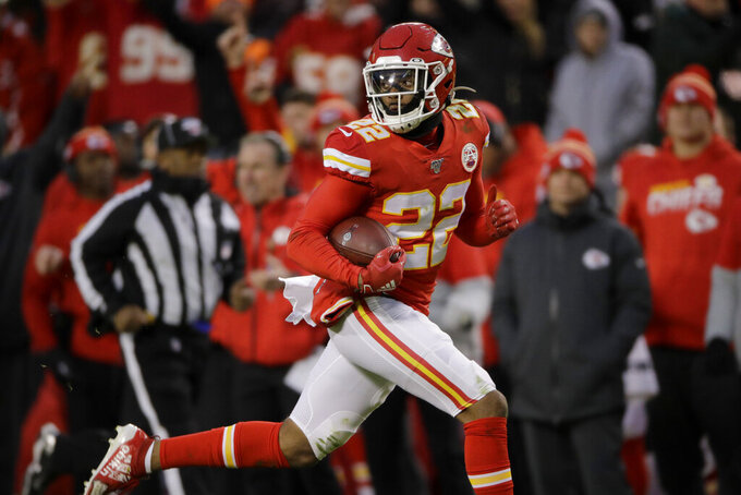 Kansas City Chiefs safety Juan Thornhill (22) runs for a touchdown after intercepting a pass intended for Oakland Raiders wide receiver Keelan Doss during the first half of an NFL football game in Kansas City, Mo., Sunday, Dec. 1, 2019. (AP Photo/Charlie Riedel)