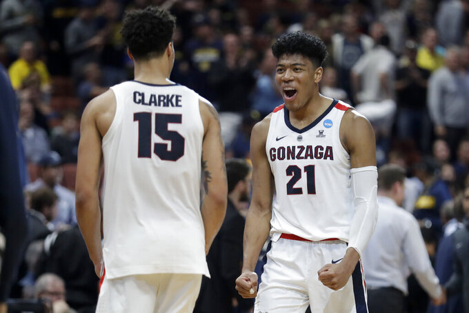 Gonzaga forward Rui Hachimura, right, and forward Brandon Clarke celebrate the team's win against Florida State during an NCAA men's college basketball tournament West Region semifinal Thursday, March 28, 2019, in Anaheim, Calif. (AP Photo/Marcio Jose Sanchez)