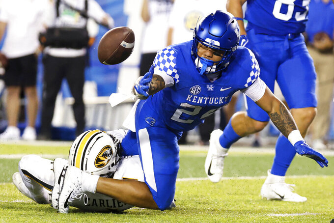 Kentucky running back Chris Rodriguez Jr. (24) fumbles the ball near the end zone during the first half of the team's NCAA college football game against Missouri in Lexington, Ky., Saturday, Sept. 11, 2021. (AP Photo/Michael Clubb)