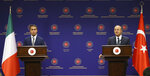 Turkey's Foreign Minister Mevlut Cavusoglu, right, and Italy's Foreign Minister Luigi Di Maio speak during a joint news conference after their talks, in Ankara, Turkey, Friday, June 19, 2020.(Fatih Aktas/Turkish Foreign Ministry via AP, Pool)