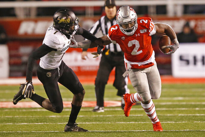 Utah running back Zack Moss (2) out runs Colorado cornerback Delrick Abrams Jr. (1) in the second half during an NCAA college football game Saturday, Nov. 30, 2019, in Salt Lake City. (AP Photo/Rick Bowmer)