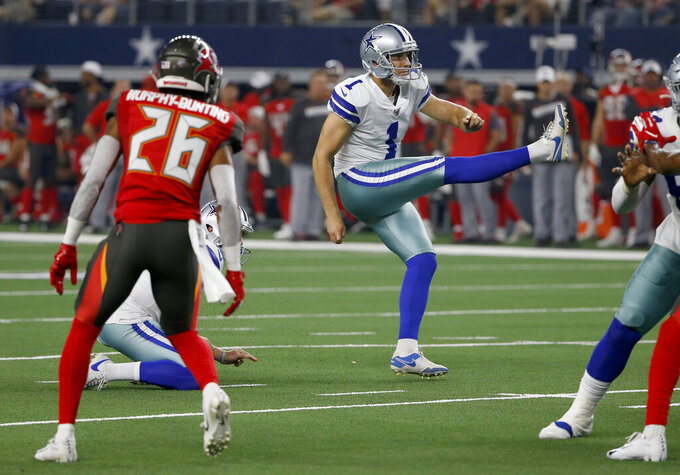 Tampa Bay Buccaneers defensive back Sean Murphy-Bunting (26) looks on as Dallas Cowboys punter Kasey Redfern (1) kicks a field goal in the first half of a preseason NFL football game in Arlington, Texas, Thursday, Aug. 29, 2019. (AP Photo/Ron Jenkins)