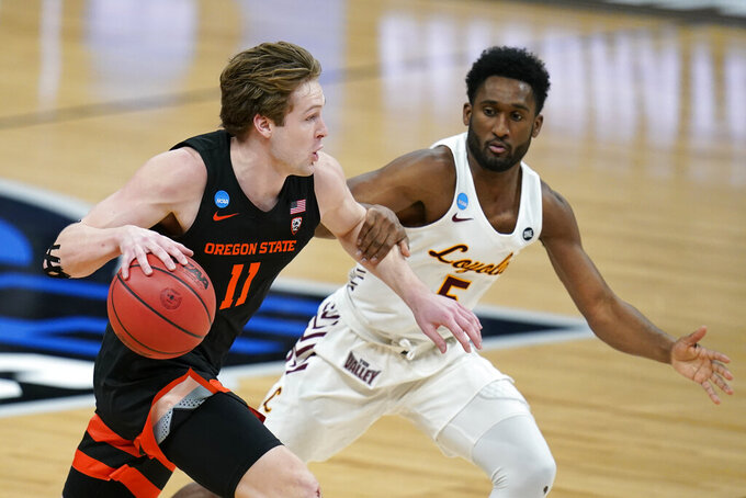 Oregon State guard Zach Reichle (11) drives up court ahead of Loyola Chicago guard Keith Clemons (5) during the second half of a Sweet 16 game in the NCAA men's college basketball tournament at Bankers Life Fieldhouse, Saturday, March 27, 2021, in Indianapolis. (AP Photo/Jeff Roberson)