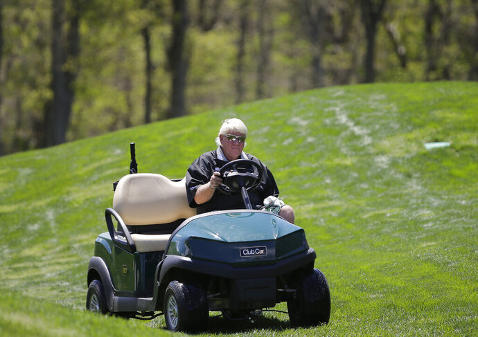 John Daly drives to the fifth green in a cart during a practice round for the PGA Championship golf tournament, Wednesday, May 15, 2019, at Bethpage Black in Farmingdale, N.Y. (AP Photo/Seth Wenig)