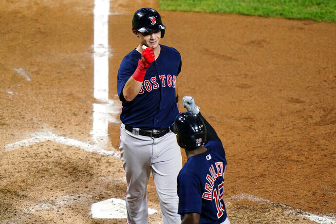 Boston Red Sox's Bobby Dalbec, left, and Jackie Bradley Jr. celebrate after Dalbec's two-run home run off Philadelphia Phillies pitcher David Phelps during the sixth inning of the second baseball game in a doubleheader, Tuesday, Sept. 8, 2020, in Philadelphia. (AP Photo/Matt Slocum)