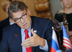 U.S. Secretary of Energy Rick Perry gestures as he speaks to Russian Energy Minister Alexander Novak during their talks in Moscow, Russia, Thursday, Sept. 13, 2018. (AP Photo/Alexander Zemlianichenko)