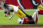 Pittsburgh Steelers quarterback Devlin Hodges (6) is tackled by Arizona Cardinals defensive tackle Rodney Gunter during the first half of an NFL football game, Sunday, Dec. 8, 2019, in Glendale, Ariz. (AP Photo/Rick Scuteri)