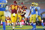 Southern California wide receiver Drake London (15) celebrates a touchdown with wide receiver Amon-Ra St. Brown (8) during the third quarter of an NCAA college football game against UCLA, Saturday, Dec 12, 2020, in Pasadena, Calif. (AP Photo/Ashley Landis)