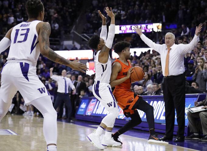 Oregon State coach Wayne Tinkle, right, reacts as Oregon State guard Stephen Thompson Jr., with ball, tries to get around Washington guard David Crisp during the second half of an NCAA college basketball game Wednesday, March 6, 2019 in Seattle. Washington won 81-76 in overtime. (AP Photo/Ted S. Warren)