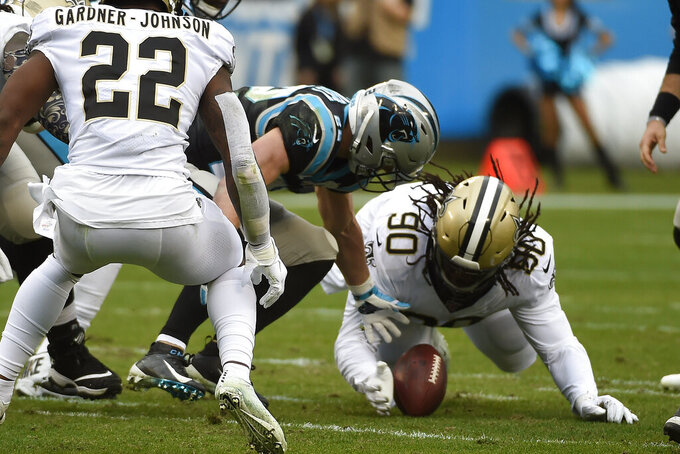 New Orleans Saints defensive tackle Malcom Brown (90) recovers a fumble by Carolina Panthers running back Christian McCaffrey during the first half of an NFL football game in Charlotte, N.C., Sunday, Dec. 29, 2019. (AP Photo/Mike McCarn)