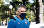 Mattia Maestri waits for the start of a 180-kilometer relay race, in Codogno, Italy, Saturday, Sept. 26, 2020. Italy's coronavirus Patient No. 1, whose case confirmed one of the world's deadliest outbreaks was underway, is taking part in a 180-kilometer relay race as a sign of hope for COVID victims after he himself recovered from weeks in intensive care. Mattia Maestri, a 38-year-old Unilever manager, was suited up Saturday for the start of the two-day race between Italy's first two virus hotspots. It began in Codogno, where Maestri tested positive Feb. 21, and was ending Sunday in Vo'Euganeo, where Italy's first official COVID death was recorded the same day. (AP Photo/Antonio Calanni)