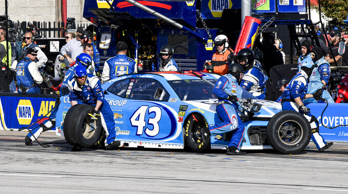 Bubba Wallace's (43) pit crew services his car during a NASCAR auto race at Texas Motor Speedway, Sunday, Nov. 3, 2019, in Fort Worth, Texas. (AP Photo/Larry Papke)