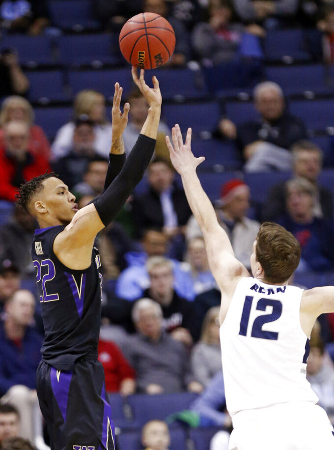 Washington's Dominic Green, left, shoots over Utah State's Justin Bean in the first half during a first round men's college basketball game in the NCAA Tournament in Columbus, Ohio, Friday, March 22, 2019. (AP Photo/Paul Vernon)