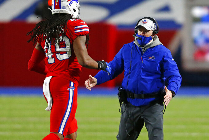 Buffalo Bills head coach Sean McDermott, right, celebrates with Tremaine Edmunds as he comes off the field during the first half of an NFL football game against the Pittsburgh Steelers in Orchard Park, N.Y., Sunday, Dec. 13, 2020. The Bills won 26-15. (AP Photo/Jeffrey T. Barnes )