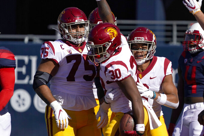 Southern California running back Markese Stepp (30) celebrates with teammates after scoring against Arizona in the first half during an NCAA college football game, Saturday, Nov. 14, 2020, in Tucson, Ariz. (AP Photo/Rick Scuteri)