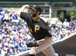 Pittsburgh Pirates starting pitcher Trevor Williams (34) throws the ball against the Chicago Cubs during the first inning of a baseball game, Sunday, July, 14, 2019, in Chicago. (AP Photo/David Banks)