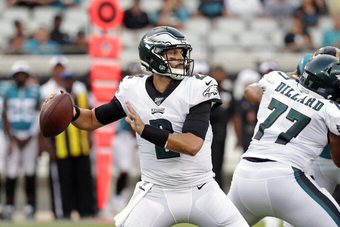 FILE - In this Aug. 15, 2019, file photo, then-Philadelphia Eagles quarterback Cody Kessler (2) throws a pass during the first half of an NFL preseason football game against the Jacksonville Jaguars, in Jacksonville, Fla. The Patriots have signed Cody Kessler to their 53-man roster, adding some additional depth behind quarterback Tom Brady. Kessler spent last season with the Eagles, appearing in five games with four starts.(AP Photo/John Raoux, File)